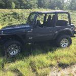 2004 Jeep TJ - Drive Side in Grass