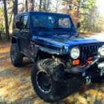 2000 Jeep TJ - Topped Passenger Front